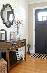 modern farmhouse entryway painted in sherwin williams iron ore and balanced beige