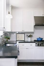 white kitchen cabinets with black counters