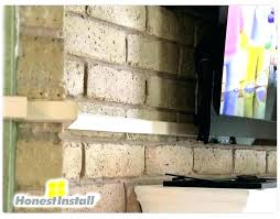 mount tv to brick fireplace how to hide wires over brick fireplace mounting above brick fireplace