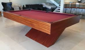 the houdini pool table in a wood veneer with burdy cloth