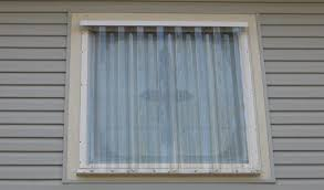 plastic panels protect windows from flying debris photo courtesy of speas storm shutters