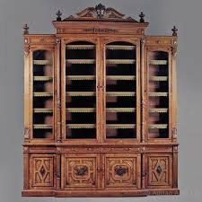 a large carved oak and pollard oak breakfront library bookcase