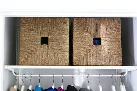 ikea knipsa baskets to hold hats gloves and scarves in an organized coat closet