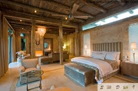 Original Country Style Bedroom With Wooden Ceiling, Decorative Antlers And  Wide Bed