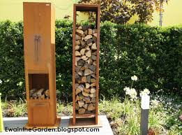 this portable outdoord fireplace in rusted steel seems to me very handy and very stylish additionally vertical twin storage for wood doesn t take too much