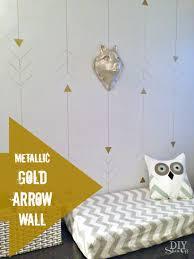 metallic gold arrow wall at diyshowoff com arrow accent wall tutorial