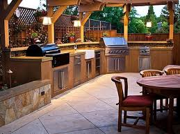 outdoor kitchen lighting ideas. Classic Outdoor Kitchen Design With L Shaped Cabinets Using Rustic Pendant Lighting Ideas