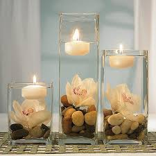 square glass vases set upside down with citrus and candles