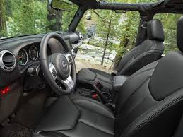 despite a set of modest upgrades the interior of the jeep wrangler still feels dated