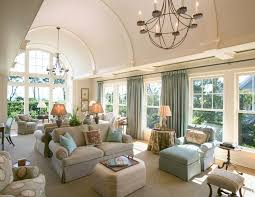 living room vaulted. a large and luxurious living room is shown here under bright curved vaulted ceiling