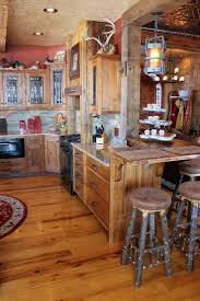 in style kitchen cabinets: rustic reclaimed barnwood custom kitchen cabinets wrought iron hardware roughing it in style