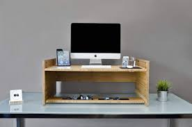 this gorgeous and elegant bamboo gadget will turn any desk into a standing desk cult of mac