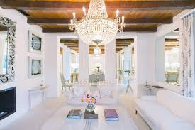 illuminated chandelier over luxury living room stock photo