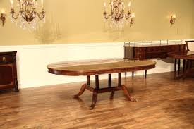 54 round to oval mahogany dining table with 2 leaves