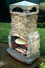 outdoor fireplace with pizza oven above smoker