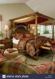 Period Bedroom Furniture Period Style Four Poster Bed In Traditional Style Bedroom Stock