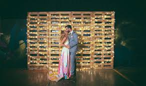 pallet and string light ceremony backdrop