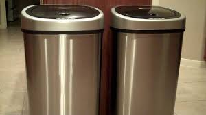 pair stainless steel kitchen trash cans with black double top near wooden kitchen cabinet