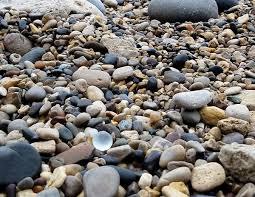 wave tumbled sea glass bauble resting on ryhope dene beach
