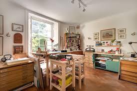 home art studio design. art studio home office traditional with book binding natural light design d