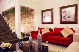 modern white living room with red sofa