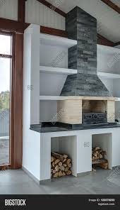 Gray Brick Fireplace Light Room With Brick Fireplace With Gray Brick Chimney In The