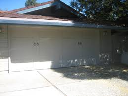 steel overlay carriage garage doors steel collection 2 car solid top with ring handle hardware