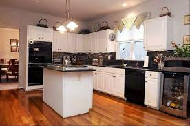 Image Black Appliances Installed In The Traditional Kitchen Featured White Cabinets Fashionable And Sophisticated Kitchen Black Wearefound Home Design Black Appliances Installed In The Traditional Kitchen Featured White