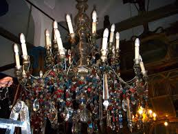 obviously it predates electricity and operated originally with oil lamps hence the greek name polyelaios which means