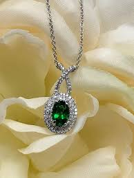 oval green emerald with diamond halo
