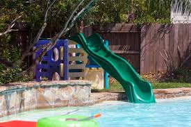 slide is bolted securely through the heavy plastic of the play set and spent about 7 on a good shower style hose head we already had the old play