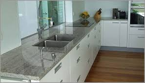 white kashmir granite perfectly offsets the lines of the hardwood floor