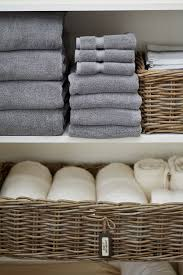 organize linen by room and each bathroom into baskets and label