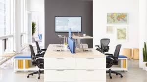 pictures of an office. A Shared Workspace With Aeron Chairs, Inside Of An Office Full Natural Light. Pictures