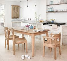 astounding dining room with extendable dining table and cooktop also kitchenshelving