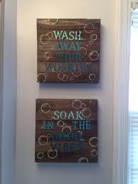 Blue DIY bathroom wall decor. $10 wood canvas from Walmart, stencils,  acrylic paint