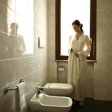 european style bathrooms typically feature tile on both the floor and walls