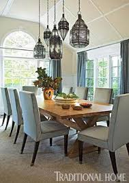 hung at sgered heights luminous lanterns for light from morocco cast a dazzling glow on a rustic wooden table photo john bessler design young huh