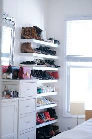 our small living space where did get that ikea lack wall shelf corner shoe storage ideas michael installed these white floating shelves from howard miller