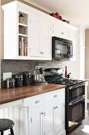 Black Appliances and White or Gray Cabinets  How to Make it Work | Black  appliances, White cabinets and Decorating