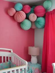 hanging paper lanterns also lists where to buy for cheap  martha stewart pink and teal paper lanterns for a girl modern nursery from livethefancylife com
