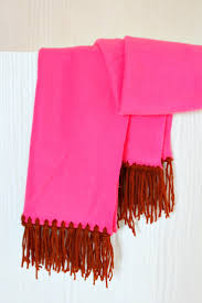 no sew fleece scarf in pink fleece with fringe made from brown yarn