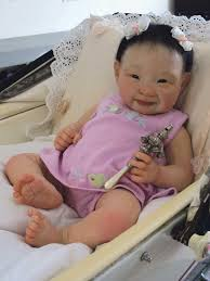 Lifelike baby dolls to be used therapeutically for women who have ...
