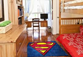 superman logo rug in a childs room