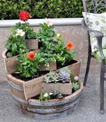 well here is a beautiful mini garden that was created from an old wine barrel you will find step by step directions and one of these awesome gardens can be