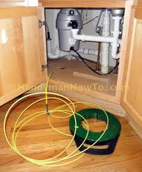 Under Kitchen Sink Cabinet How To Wire An Electrical Outlet Under The Kitchen Sink Fishing Cable