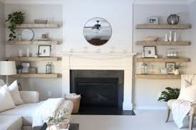 thick wooden shelves on both sides of the fireplace add a farmhouse feel
