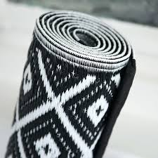 plastic black and white outdoor rug