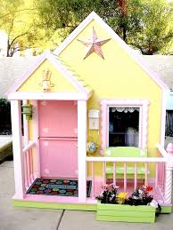 pink and yellow playhouse for kids backyard play area