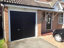 black garage door home design ideas homecm pertaining to black garage doors houses with black garage